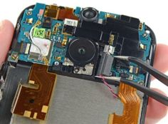 HTC One M8 being torn down at the hands of iFixit.