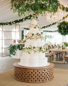 An Epic New Orleans Wedding with Classic Touches | Martha Stewart Weddings - Sweetpeas, roses, and other blooms wound around the six-foot-tall white-chocolate chiffon cake by Melissa's Fine Pastries, which was layered with blueberry compote and lavender mascarpone (Haylie's favorite flavors).