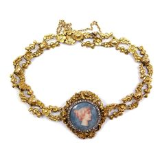 19th century French gold bracelet with an enamel neoclassical profile by Frederic Boucheron, Paris c.1880,