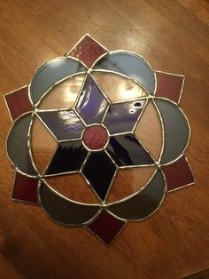 Star stained glass sun catcher.