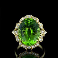 Gorgeous Peridot and Diamond Ring. A bright and lively faceted oval Peridot is enthroned in a lovely, feminine 18 karat yellow gold and diamond setting with Edwardian era influences
