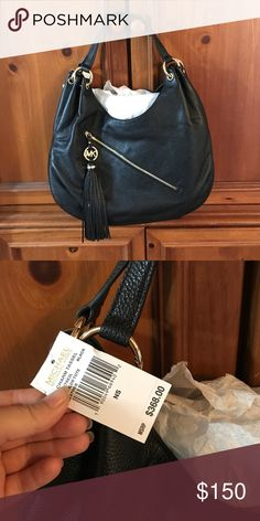 Large black Michael Kors Bag Large shoulder bag. Brand new with tags, never worn! Perfect to fit everything and still fit comfy under your shoulder. Michael Kors Bags Hobos