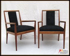 This is a beautiful pair of sculptural Danish arm chairs. These chairs are walnut wood with new black upholstery fabric. The chairs measure 33-3/4 tall, they are 22-1/4 wide and 22-1/2 deep. The seats are 19 tall and the seat backs are 17-1/4 tall. The chairs are in excellent condition with no damage. On close inspection they may show a vintage scuff or two, but nothing outstanding or noticeable. These nice chairs come from a smoke free and pet free home, they are clean a...