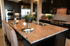 dark cabinets with light countertops | Kitchen Idea - Dark cabinets with light countertops. | Home Ideas