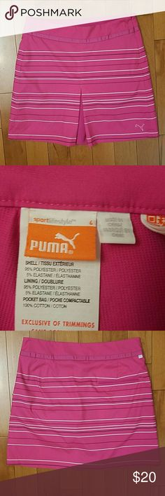 """Pink Puma Golf or Tennis Skort Pink Striped Puma Golf or Tennis Skort.   Side zip with shorts underneath for coverage.  Size 6.  There are a few tiny holes in waistband where the tags were (see pic), but hardly noticeable.  17"""" long.   16"""" across waistband.   Super cute!! Puma Shorts Skorts"""