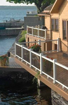 EverNew PT Decking in Ipe and and Panorama composite railing system in White creates a spacious, low-maintenance outdoor room.