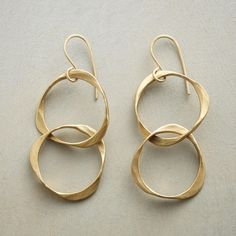 "MODERNIST BRASS EARRINGS -- Renee Garvey links appealingly irregular rings, creating kinetic sculptures that sway at the ears. Hammered matte brass rings suspended from 10kt gold French wires. Handcrafted in USA. 2""L."
