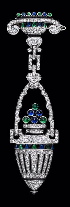Van Cleef & Arpels - An Art Deco diamond, emerald and sapphire lapel watch, circa 1920. #VanCleefArpels #ArtDeco
