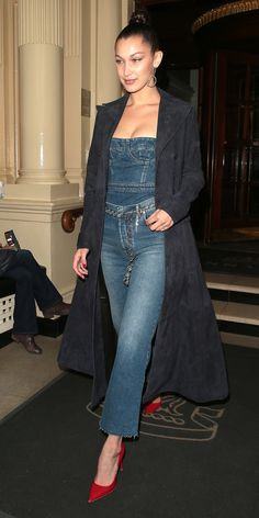 Bella Hadid goes all denim with a pop of red.
