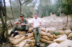 Marines taking a break on the perimeter of the MAG 12 Security Company Chu Lai, Viet Nam; May 1965. ( L ) Bill Thornton from Oregon and ( R ) Bill Ferguson from Florida enjoy a break before building a bigger hole. Lots of hole digging and sand bag fi Viettel IDC Cho thue cho dat, cho thue may chu, may chu, hosting, domain, vps, cloud computing, email, vpn
