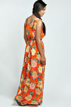 Not too sure about maxi dresses, but I love this print and the cut of the top of the dress.