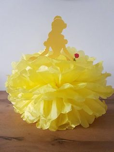 Shes the belle of the ball, or pompoms at least! This decoration is perfect for any Beauty and the Beast party or Disney princess themed birthday, baby shower, christening, baptism or name day. Designed to be suspended from the ceiling, hang this decoration above your party table