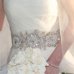 About that belt: It's likely that Chelsea wanted a touch of glamour, but perhaps felt that all-over glitz would be too much of a departure from her everyday style. Because it was hand-beaded, featuring the finest (and priciest) crystals, the belt alone might have cost $800 or more.