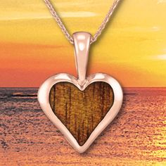 14K Rose Gold Heart Pendant with Koa Wood Inlay and Diamond:  Native to the Hawaiian Islands, the beautiful Koa wood inlay that Na Hoku features embodies great spiritual significance in Island culture and has been treasured since ancient times. Traditionally used to create gifts for royalty, the strength and resilience of Koa encompasses many meanings, including courageous, bold and fearless.