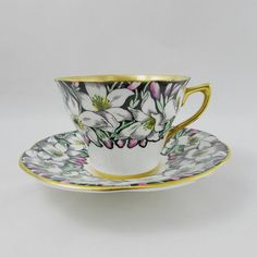 Rosina Tea Cup and Saucer with Black Border and White Flowers