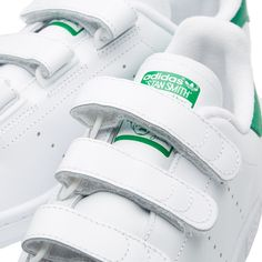 First debuting in 1971 as a tennis all-star sneaker, the adidas Stan Smith has defined itself as a modern streetwear legend. This classic court shoe is re-imagined for lace-free comfort while maintaining the clean and casual aesthetic it is renowned for. Retaining the familiar feature of perforated 3-stripe branding, this iteration swaps out the laces in place of three adjustable Velcro straps for a personalised fit. Leather Uppers Perforated Stripes Lace-Free Comfort Three Velcro Closur...