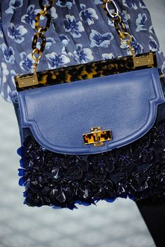Tory Burch. Love the contrast of tortoiseshell with periwinkle