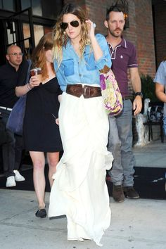 denim shirt tucked into white skirt and wide brown belt