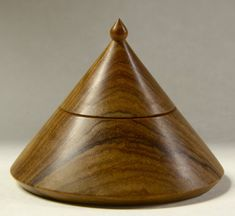 A hand turned pointy box made of luscious Olive wood. So pleasing to hold and to look at