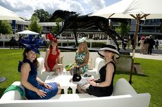 Attendees enjoying champagne at Ascot