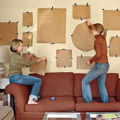 Photo Collage Wall; Avoid too many holes in the wall by taping pieces of paper first to arrange frames