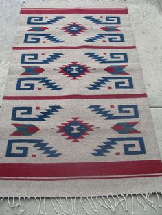 This rug is an one of kind and an unique weaving piece. This rug was hand woven on a stand up loom. The intricate geometric patterns were woven delicately to make the rug an unique piece. This rug is a 100% eco-friendly product. It was made in Oaxaca Mex.    Dimension: Width: 32 inches  Length: 60 inches.    The rug is thick and it has reverse side; both sides are equal     It can be used as a wall hanging or as a floor mat.    Material: Sheep Wool    Care: Dry cleaning or hand wash   Visit…
