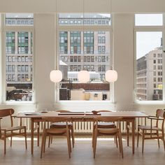 • Three drops in a row • VL45 Radiohus Pendant • Designed by Vilhelm Lauritzen •  #vl45 #vl45radiohus #vilhelmlauritzen #nyc #woodwork #diningroom #diningroomdecor #organicshapes #brass