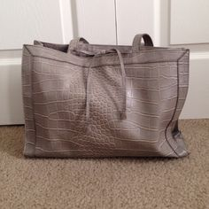 BRAND  Listing! Liz Calborne Grey purse -Lovingly used, no signs or wear and tear.  -Attached mirror inside  -Snaps shut but has an inner compartment that zips  ☑️ Bundles are encouraged  No trades. I will NOT answer to this comment. No asking lowest Offer No paypal, etc No holds ❗️All sales FINAL, no exceptions  ‼️Please remember the fees PM takes out. Be courteous and stay classy.  *Ships next day* I will not respond to offers in comments. Thanks for visiting my closet! Liz Claiborne Bags