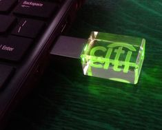 Crystal Flash Drive (or memory drive, USB stick, thumb drive) with sub-surface 3D laser engraving, green LED light, and brushed metal protective cover. Flash Drive lights up when in use, making this a powerful and beautiful conversation piece for brand promotion. Optional laser engraving of case.  Ideal as a high-end brand promotional item or with optional personalized engraving of case a great recognition award. A MUST for trade shows promotions! 4GB/Grade A.