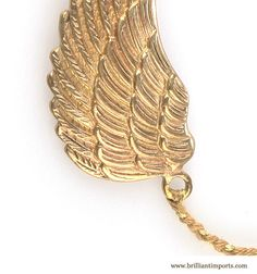 Golden Wing Bracelet, $65, With a copper wing medal and brass clasp, this easy to wear & layerable bracelet (see ideas for stacking below in 'You May Also Like') is made by hand in Bali.