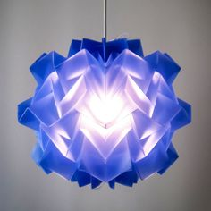 Trend: Dazzling Blue.  Dazzling blue is everywhere to be scene! With this gorgeous lighting fixture! This really can be a statement piece in any kitchen, office, or a childrens play room.  I really think that this lighting fixture is super cool and trendy.  When the light turns off it really looks like the colour of dazzling blue a really royal deep blue, and even when the light is on, it gives off this burst of light in the center as the deep blue on the perimeter stays cool.