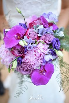 Purple orchids! A great way to add some uniqueness to your bouquet   Fairy Tale Photography