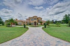 This spectacular and immaculate brand new luxurious Mediterranean 1.5-acre lake property for sale in 24-hour guard gated Stonelake Ranch, along the shores of Lake Thonotosassa, offers truly impressive architecture. Listed for $1,975,000!