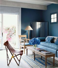 JOHN SALADINO; VERANDA; via Mark Sikes blog; blue walls; folding screen; leather butterfly chair