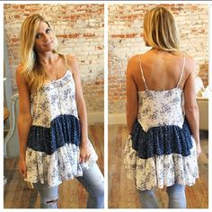 Only 2 left!!  Floral Color Block Tunic Adorable floral color block tunic! Perfect for summer! Bust: S 17in. M 18in L 19in Length: S 32in  M 33in L 34in  55% cotton 45% polyester  Please like this listing to be notified when it arrives. Infinity Raine Tops Tunics