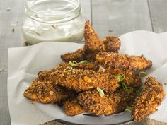 From the YOU test kitchen: Dukkah chicken strips with onion yoghurt dip