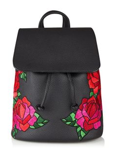 Details  Meet the bag you need right now! Our beaut embroidered Cressida backpack is so on trend with fab floral details - oh and there's plenty of room for those travel essentials. Team with one of our super cute purses to complete your look.    Material: PUDimensions: W28cm x H30cm x D12cm     Grab handle Hidden magnetic closure with drawstring fastening Internal zip pocket & twin pouches Floarl embroidered details   Delivery & Returns UK Standard Delivery - £2.95 UK Next Working Da...