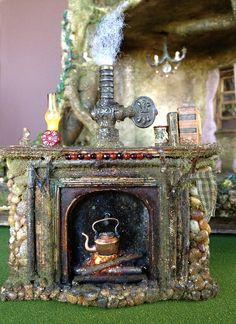 """From Tori Carpenter of fairyfurnishings on Etsy """"Fireplace for my dollhouse miniature weeping cherry bonsai tree trunk stump fairy house :)"""" Haunted Dollhouse, Dollhouse Miniatures, Fairy Land, Fairy Tales, Fairy Furniture, Kitchen Furniture, Halloween Miniatures, Fairy Crafts, Fairy Garden Houses"""