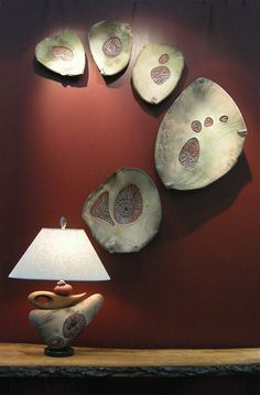 Jan Jacque is a nationally exhibited artist who creates lamps, mirrors, vessels and wall pieces combining clay and wood elements. The clay is slab formed and fired multiple times; Clay Wall Art, Ceramic Wall Art, Ceramic Clay, Clay Art, Ceramic Pottery, Pottery Art, Pottery Plates, Ceramic Bowls, Pottery Sculpture