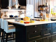 Live on the Big Island  We all know everyone gathers in the kitchen, so plan for it by designing a custom, U-shaped kitchen island using modular cabinetry and a durable countertop. It'll keep you in the middle of the action and give everyone else a place to do their thing.