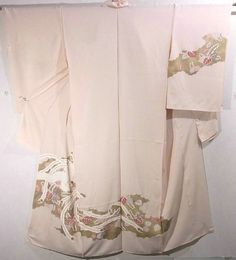 This is a kimono fabric cut into Houmongi shape and stitched roughly before sewing to make houmongi.  It has phoenix and 'kiri'(paulownia) on cloud pattern, which is dyed