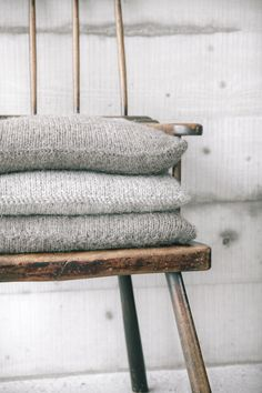 i like the idea of simple knitted cushions for chairs