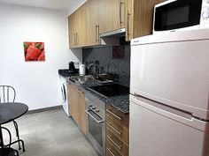 Qlodging short term rental apartment with fully equipped modern and new kitchens