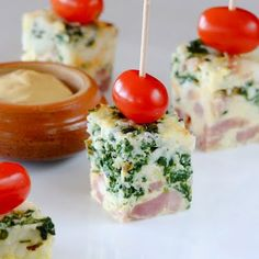 EGG CASSEROLE with HAM CHEESE and SPINACH.  Good little brunch dish if cut up into cubes.  Make ahead and chill until ready to serve then cut up and garnish.