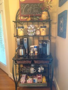 My husband rescued this baker's rack from the dump and made the perfect coffee station for us.