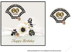 Black &amp White 60th Birthday Card by Lorna Quinney A square card front to fit an 8inch square card blank which has a white background edged with a black border.  There is a  white ribbon across the cardfront embellished with a black and white floral arrangement. There is a layered black and white fan-shaped topper containing a 60th birthday greeting in the top left corner and a gold Happy Bir
