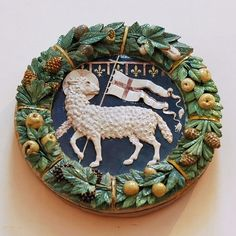 Coat of arms of the Arte della Lana (wool guild of Florence).