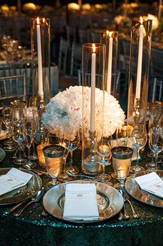 Alternating votive and taper candles is both beautiful and practical, allowing guests to interact across a stunning rece...