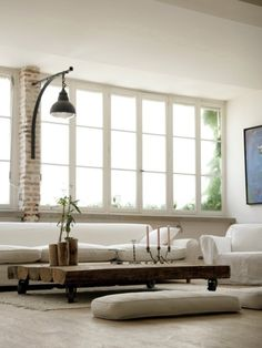 I love the low coffee table with the seating pillows around it. So cozy and inviting