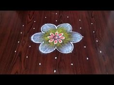 Easy rangoli simple rangoli Easy chukkala muggulu Easy latest flower design rangoli Thanks for watching 🙏🙏 P. Small Rangoli Design, Rangoli Kolam Designs, Rangoli Simple, Indian Rangoli, Hibiscus Flowers, Flower Designs, Dots, Make It Yourself, Hindus